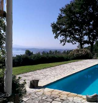 View of the pool of La Montagnola Retreat with Lake Bolsena at the background
